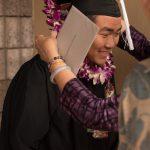 Graduate receives lei.