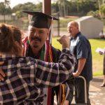 Graduate receiving congratulations.