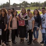 Graduate with family and friends.
