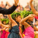Colorful keiki dancing.
