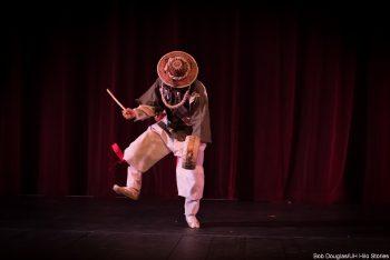 Masked performer.