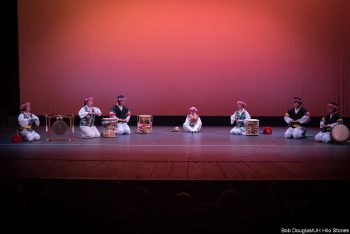 Group performing with drums.