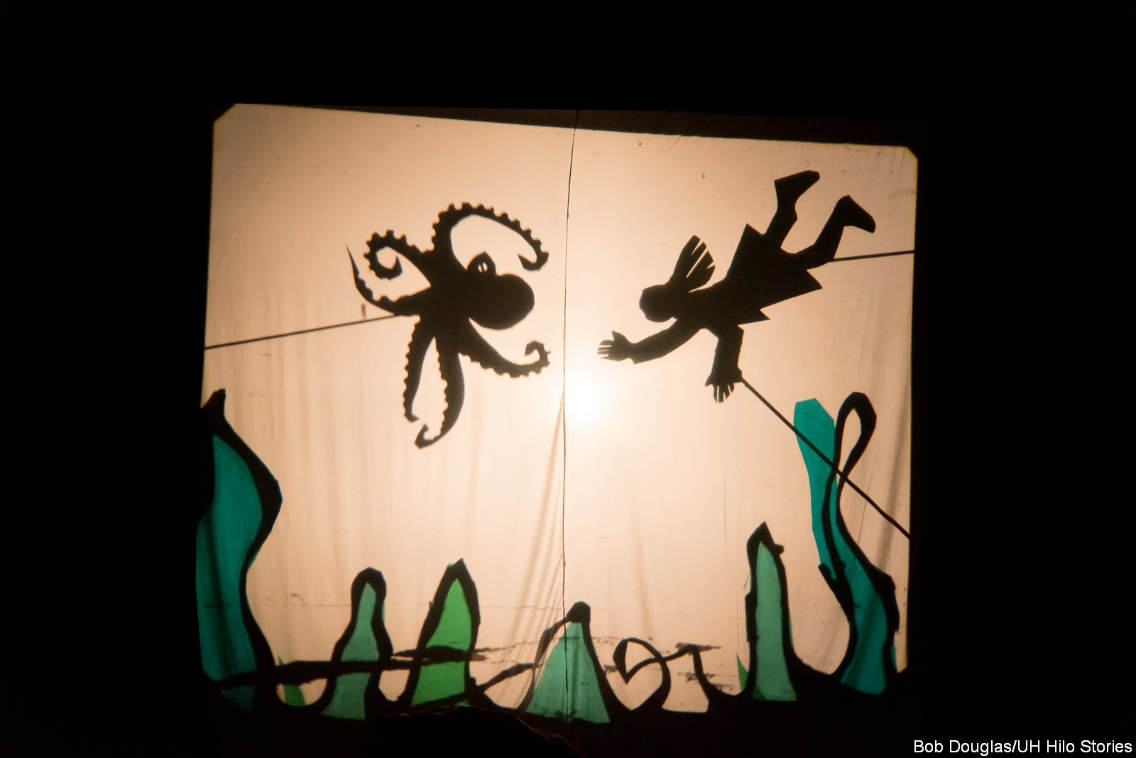 Shadow puppets on a screen.