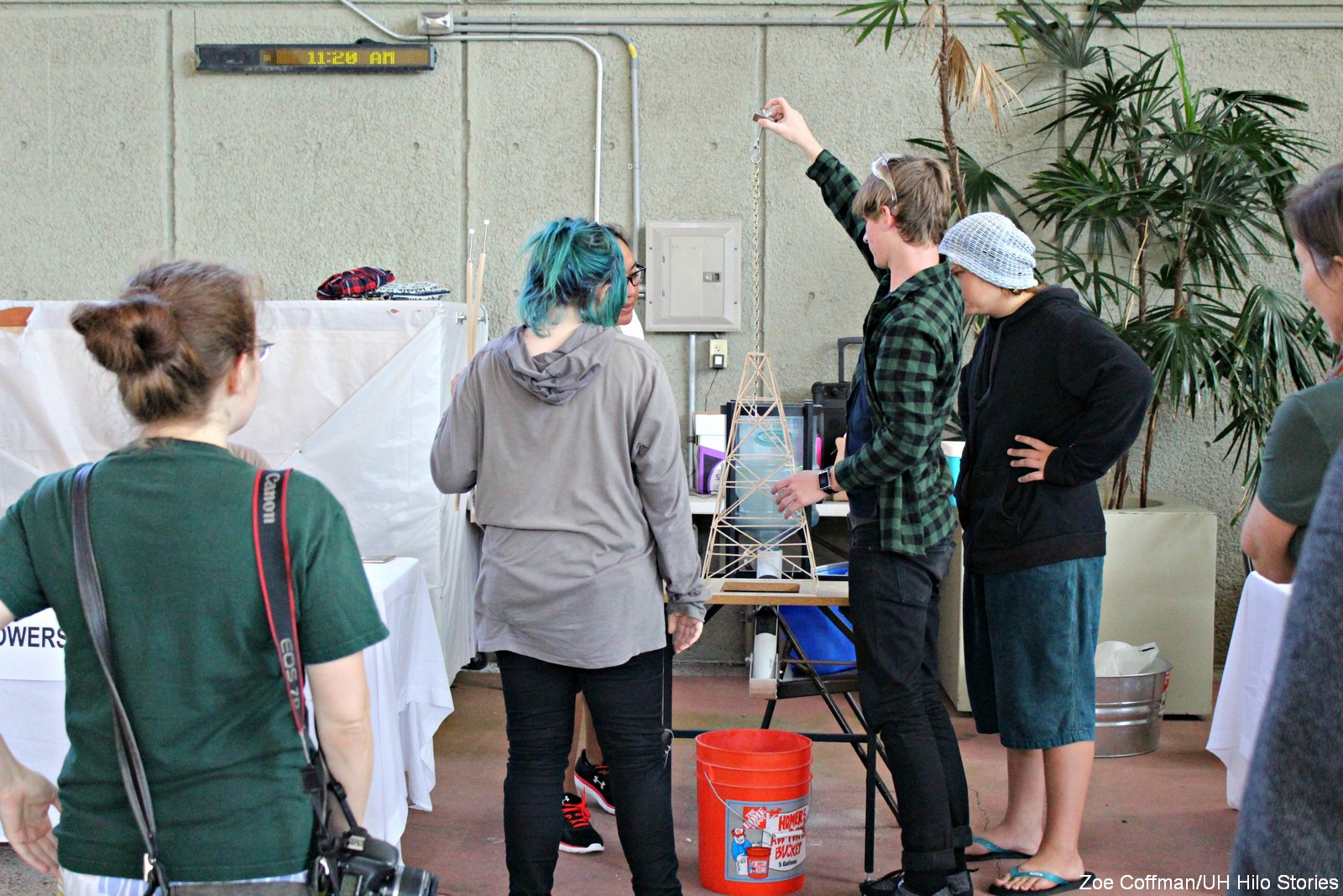 Students observe booths.