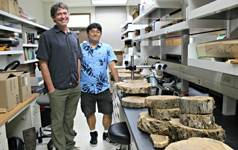 Prof Hart in his lab with student