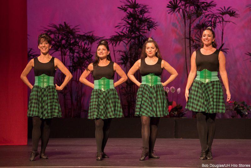 Dancers in Irish costume, green and black.