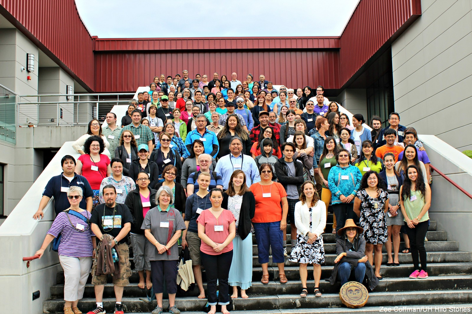 Large group stands for photo on steps of Hawaiian language college.