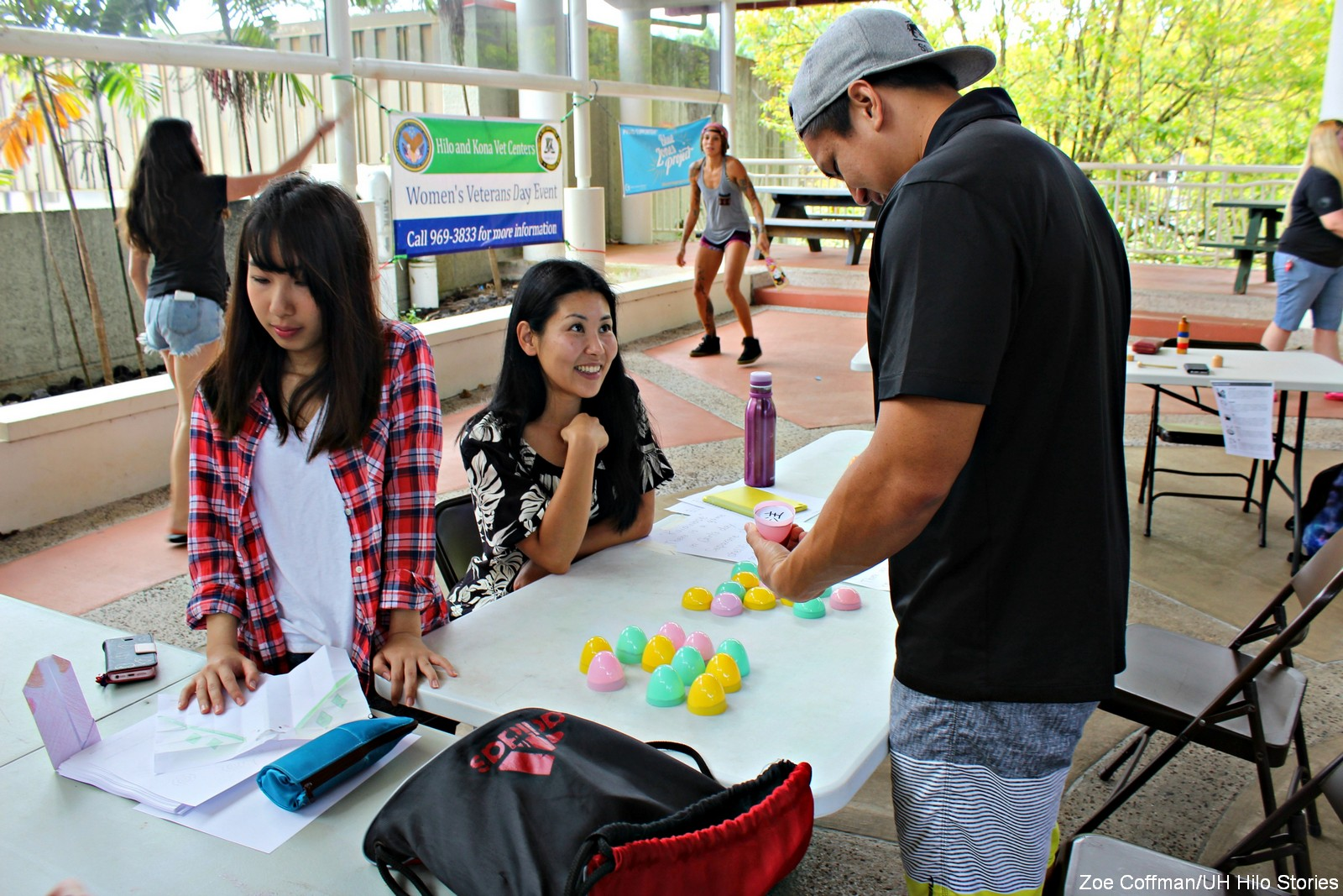 Students at a table set up at event.
