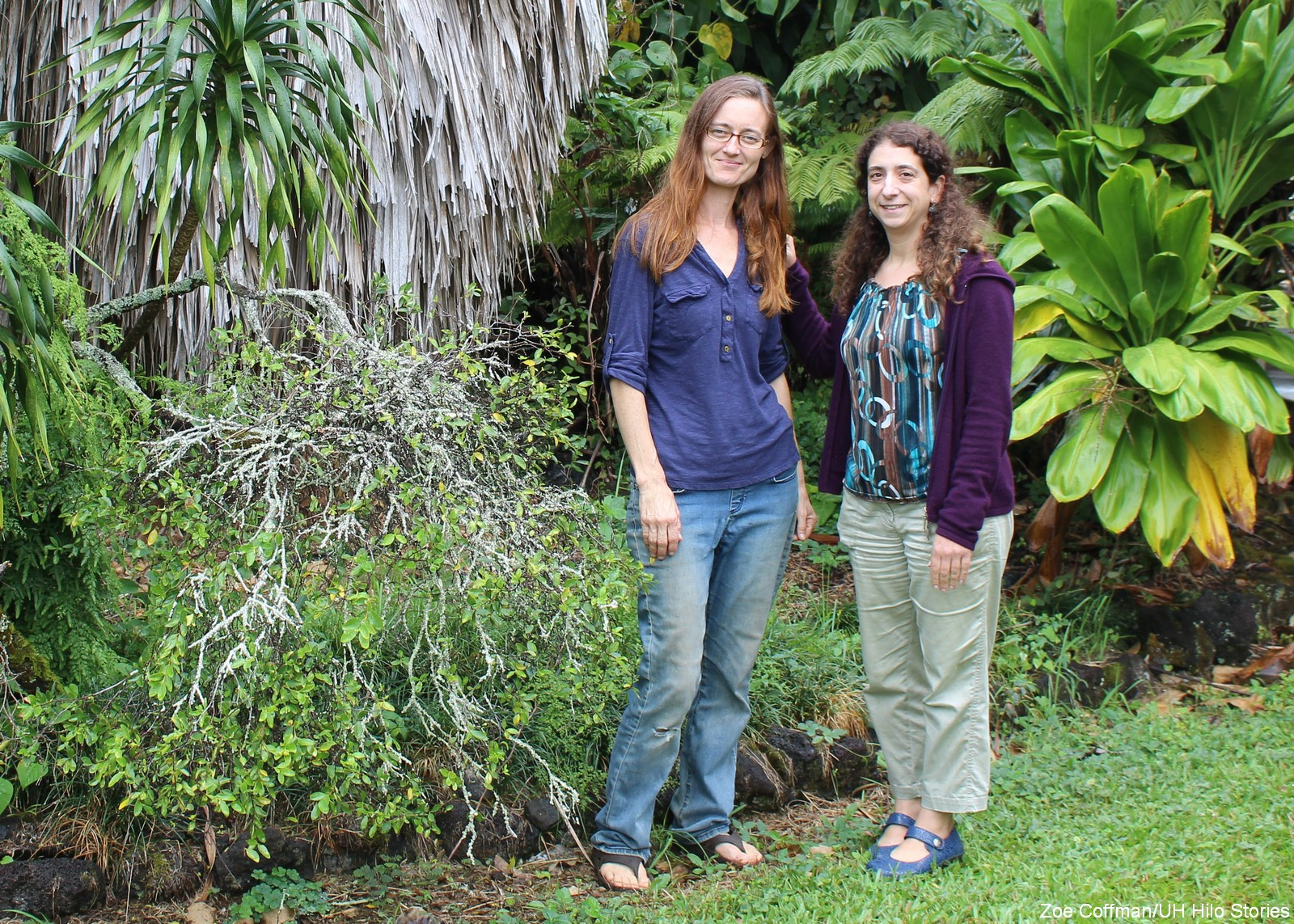 Joanna Norton and Prof. of Biology Becky Ostertag stand together in a garden.