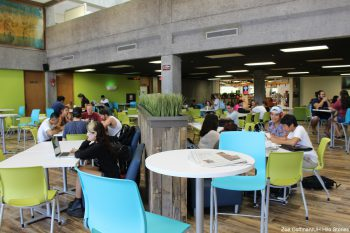 Students setaed at new cafe tables.