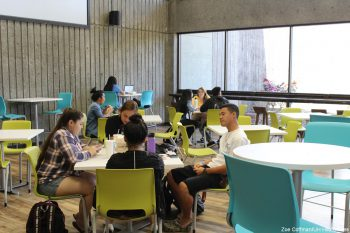 Students seated at new cafe tables and chairs.