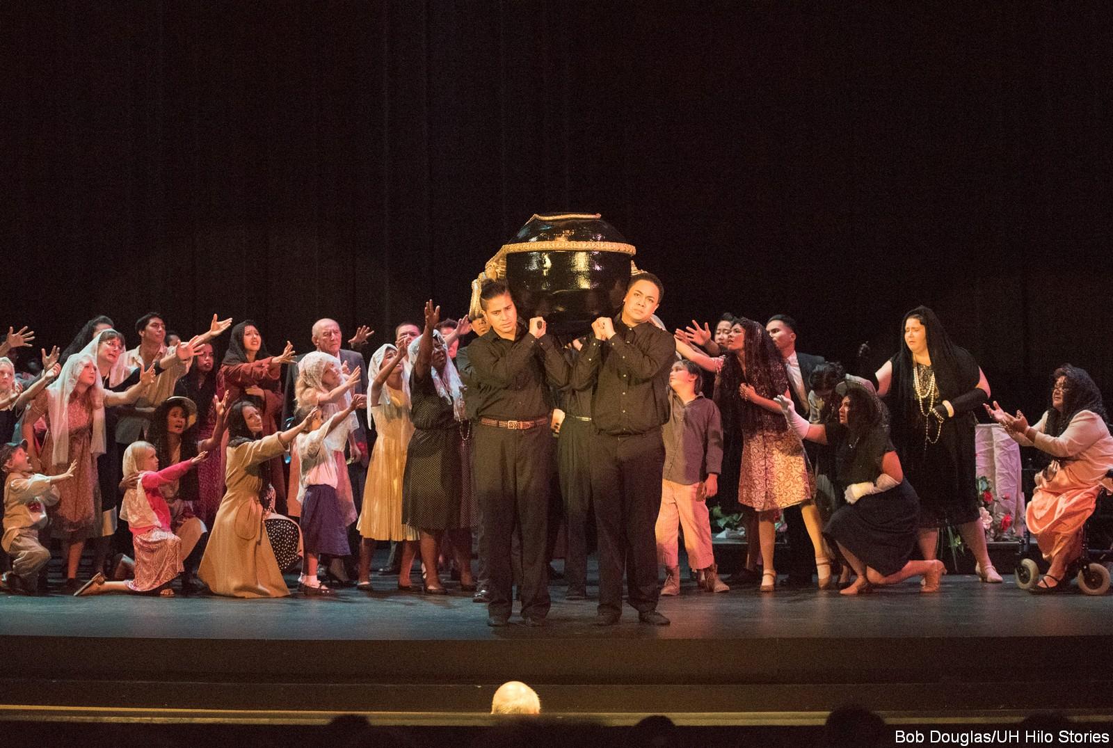 Chorus, pallbearers with coffin
