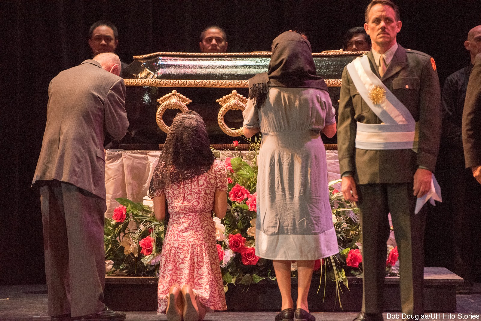 Group with casket