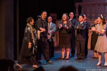 Prof. Johnson and cast on stage, bows to audience