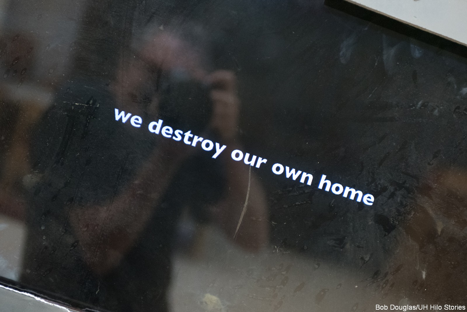"""Television with words, """"We destroy our own home"""""""