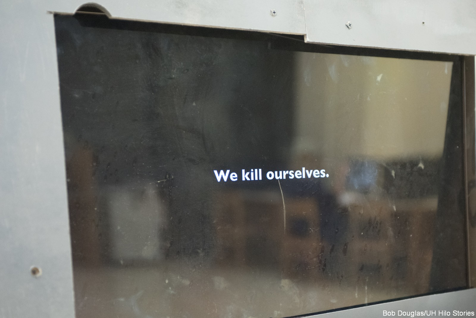 """Television with words, """"We kill ourselves"""""""