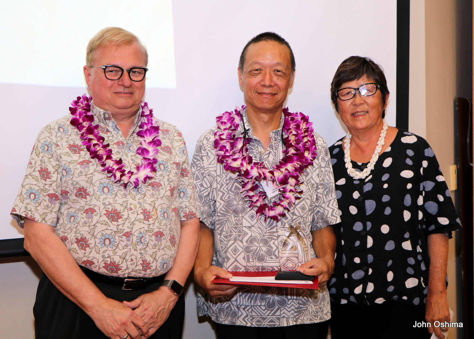 Don Straney, Lo-li Chih, and Vice Chancellor for Administrative Affairs Marcia Sakai. Chancellor and Lo-li have lei.