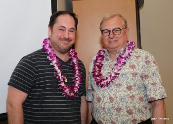 Alex Nagurney and Chancellor Don Straney stand together, both with lei.