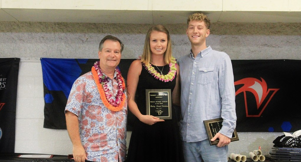Patrick Guillen, Marley Strand-Nicolaisen and Parker Farris. Recipients hold plaques. Director and Strand-Nicolaisen wear lei.