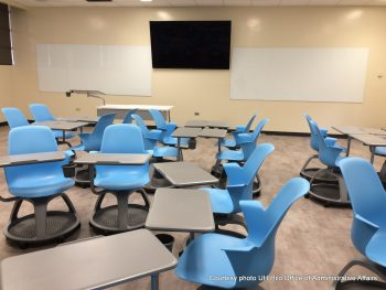 LED screen. Desks and chairs arranged in groupings to allow student to interact.