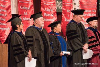 University officials in full regalia standing on dais.