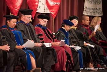 University officials in full regalia seated on dais.