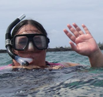 Narrissa P. Spies in ocean with mask and snorkel.