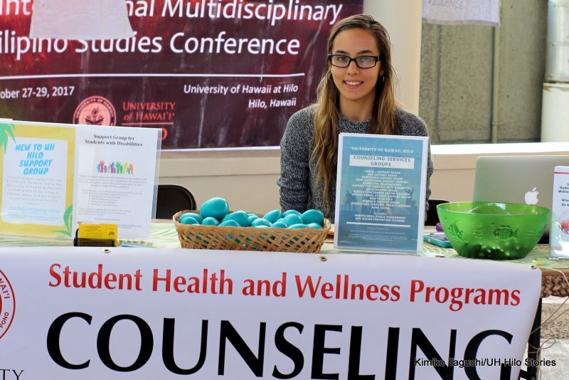 """Woman at table labeled """"Counseling."""""""