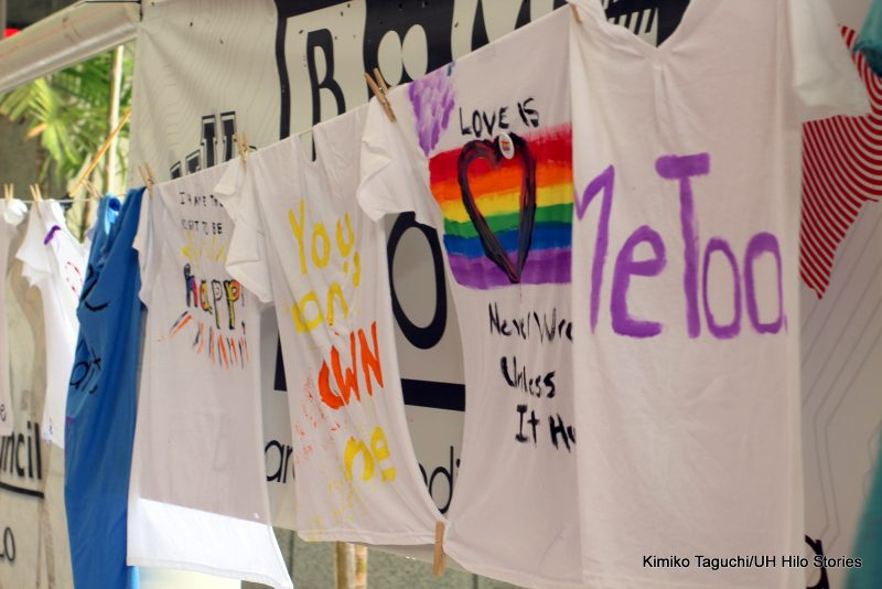 """Painted t-shirts with messages """"MeToo,"""" """"Love is never wrong unless it hurts."""""""