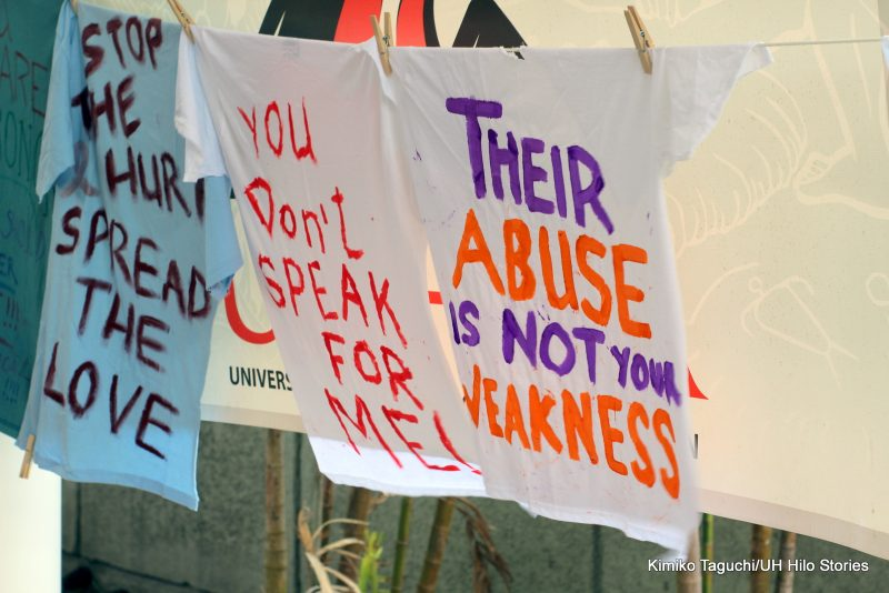 """Painted t-shirts with messages """"Their Abuse is not your weakness,"""" and """"You don't speak for me."""""""