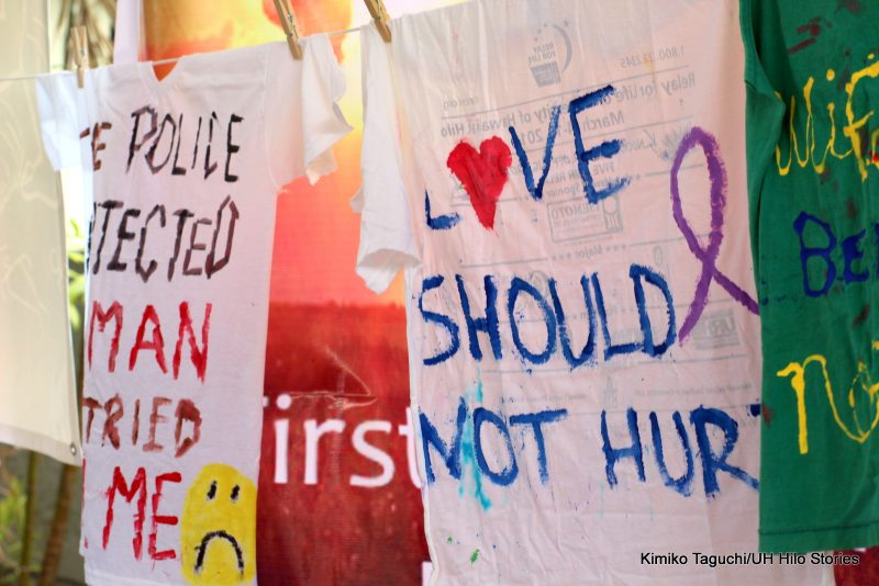 "Painted shirt with the words ""Love should not hurt."""