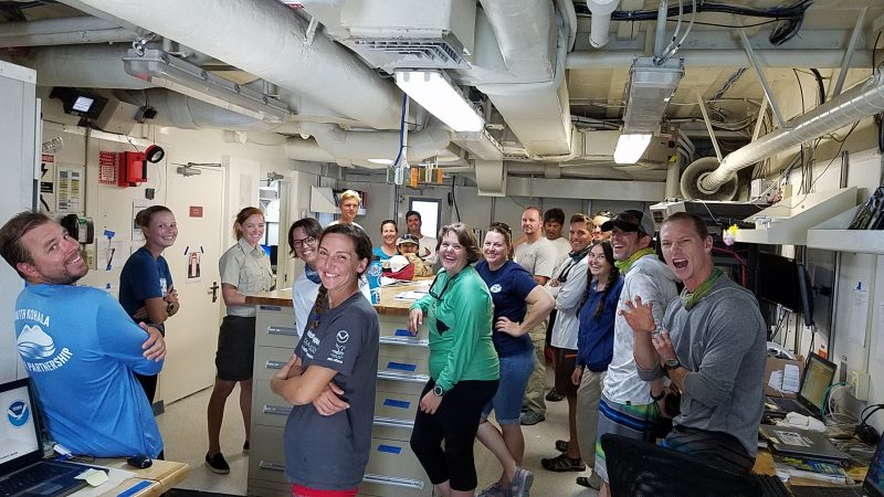 Group of researchers in boat's lab.