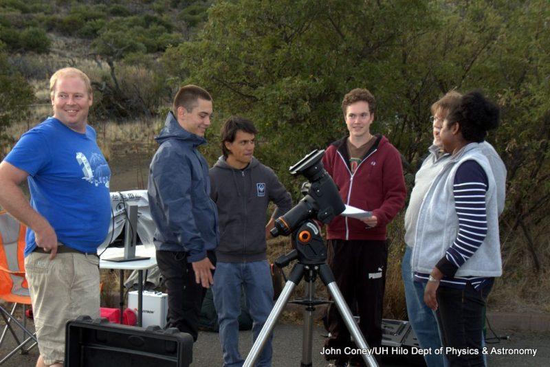 Students setting up telescope.