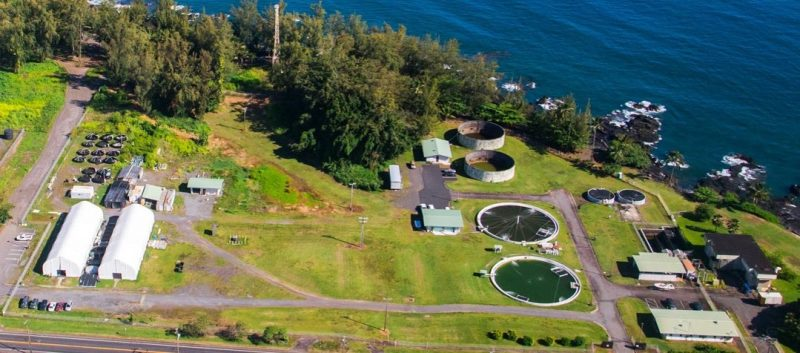 Aerial view of the facility with ponds and the edge of the bay.