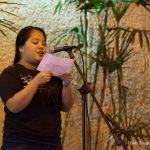 Woman at mic.
