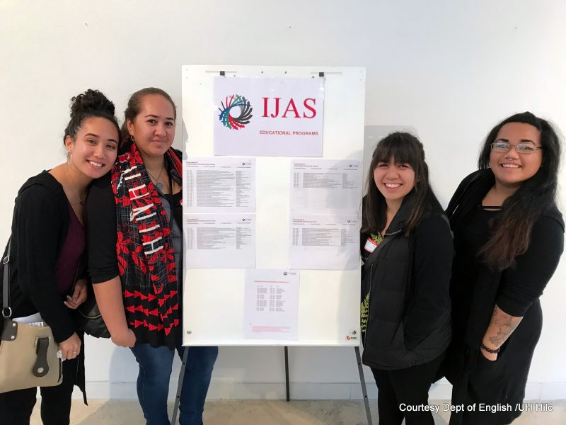 U'ilani, Leomanaolamaikalani, Tynsl, Ciarra-Lynn. stand by a poster at the conference.