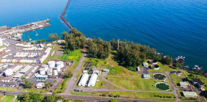 Aerial of the aquaculture center with Hilo Bay and breakwater in background.