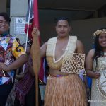 Three students in traditional attire.