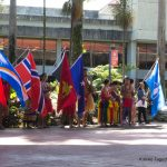 Students line up holding flags from their coountries.