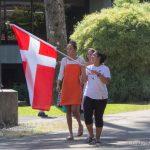 Female students holds flag.
