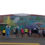 UH Hilo College of Hawaiian Language contributes to Hilo mural project celebrating Hawaiian immersion schools