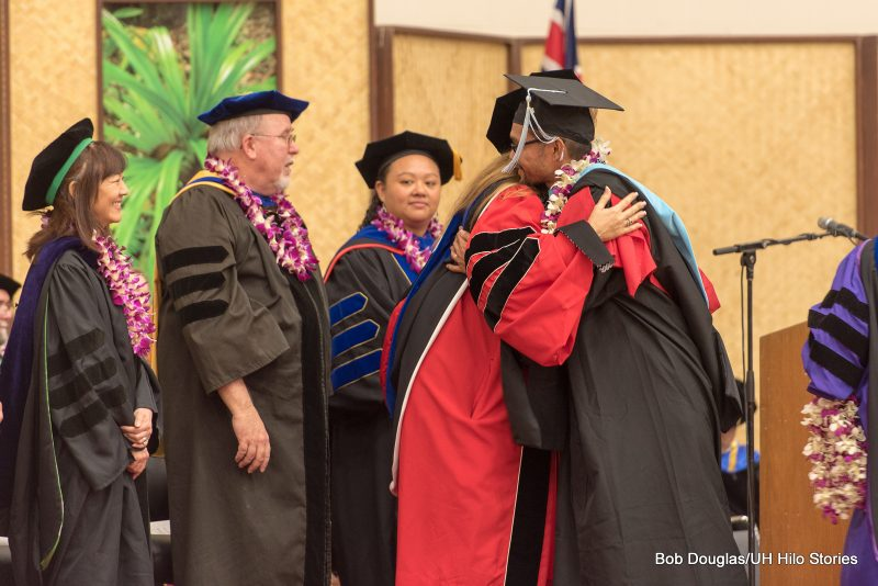 Hooding of graduate degree candidate.