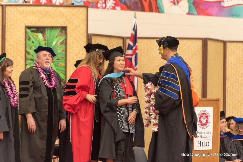 Hooding of graduate degree candidate.