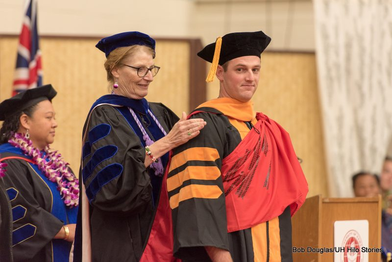 Doctoral degree candidate on dais.