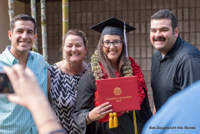 Graduate with family.
