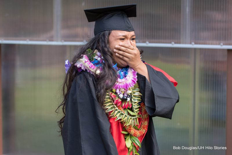 Graduate about to burst into tears of joy.