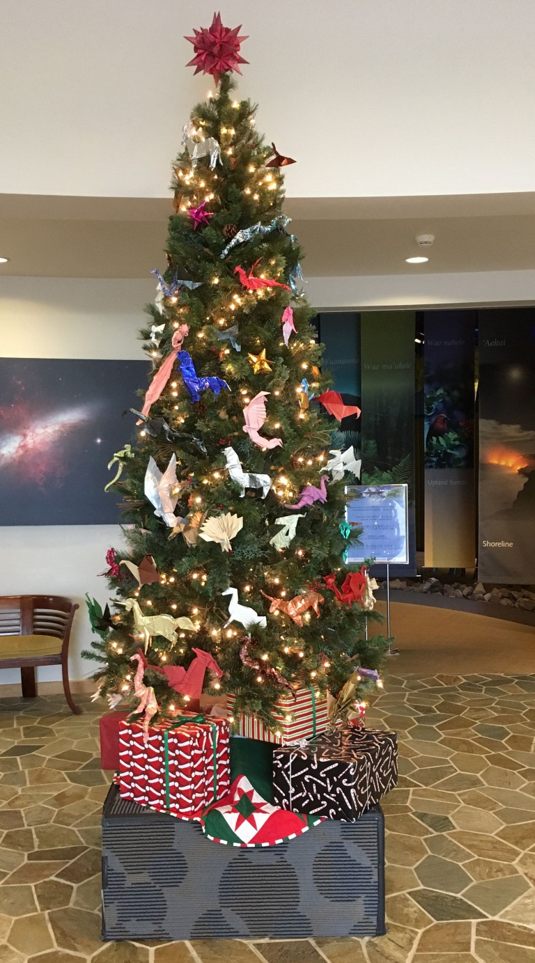 Holiday tree at 'Imiloa Astronomy Center decorated with fantastical origami creatures