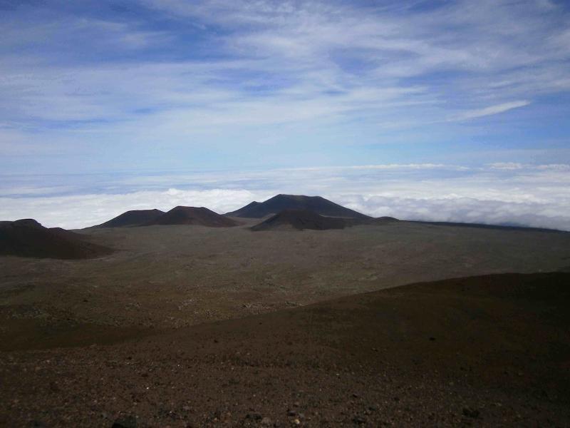 Cinder cones on barren landscape.
