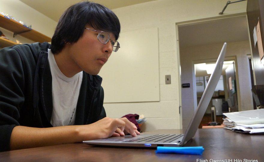 David Arakawa working on laptop.