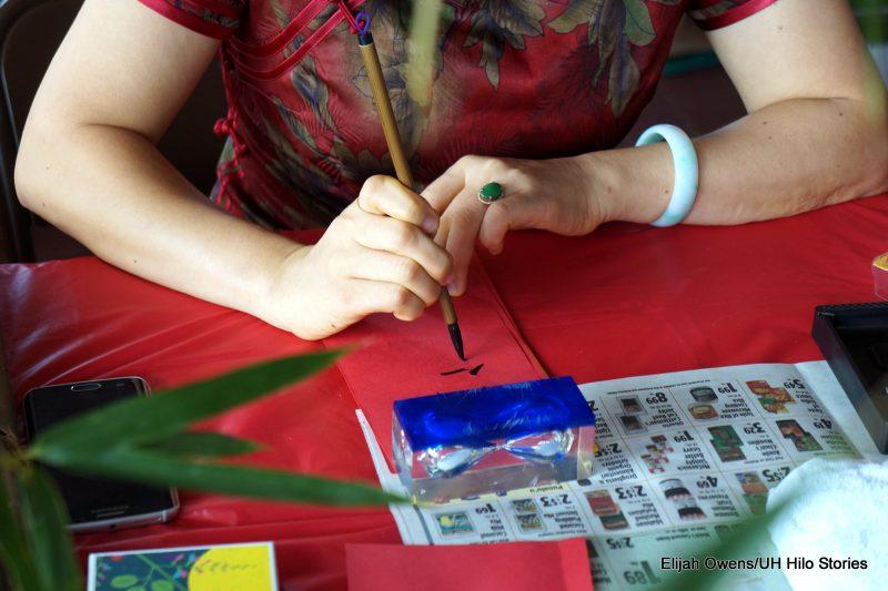 Woman doing calligraphy.